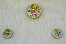Painted Plates On The Wall.