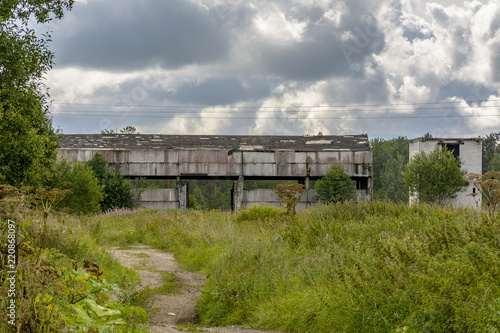 Foto op Aluminium Rudnes Abandoned agricultural buildings near the village of Muya in the Leningrad region.