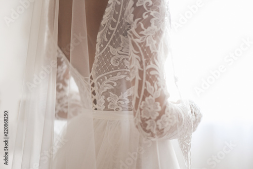 Foto Beautiful Wedding dress and white bow isolated on white background