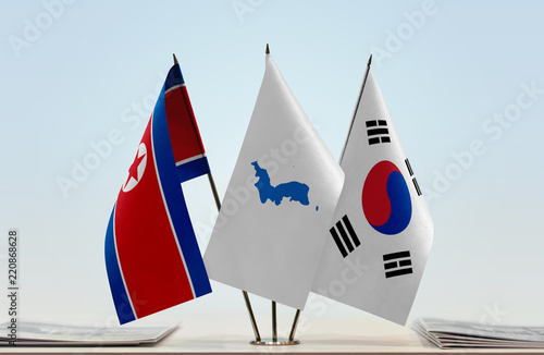 Fotografie, Obraz  Flags of North Korea and South Korea with a Korean Unification flag in the middl