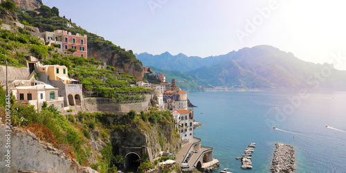 Poster Cote Stunning sunny day view of Atrani village overhanging the sea with green vineyards, Amalfi Coast, Italy