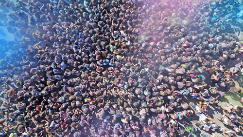 Aerial. Music concert and crowd of people in smoke. - 220875278