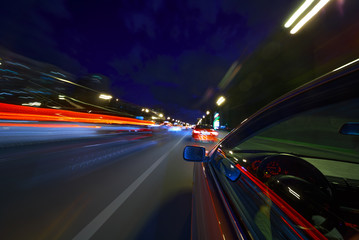 View from Side of Car moving in a night city
