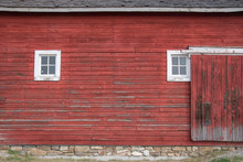 Side Of An Old Red Barn With W...
