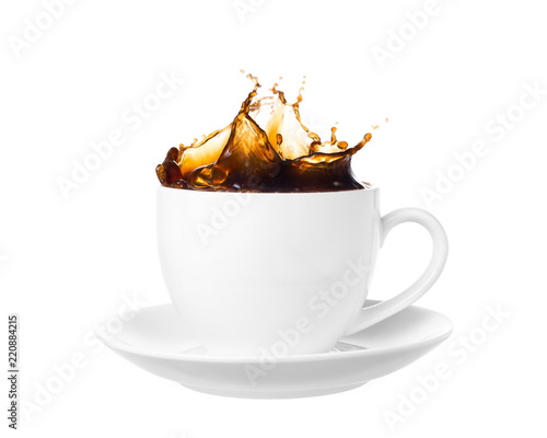 Coffee splash out of a cup isolated on white background. Canvas Print