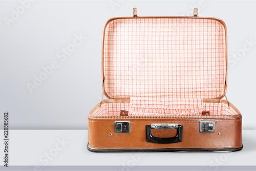Empty Vintage Suitcase open isolated on green Fototapeta