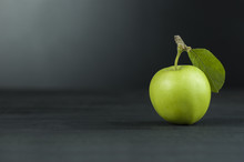 Green Fresh Apple With Leaf On Black Wooden Table