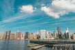 Manhattan view from Gantry park in the beautiful early morning. Long fishing pier.
