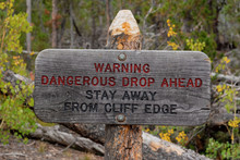 Warning Sign Dangerous Drop Ahead Stay Away From Cliff Edge