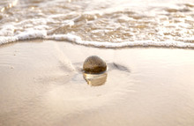 Glass Ball Crystal Clear Reflecting The Sea And Beach In The Morning