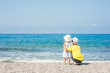 Boy embracing baby girl on the beach on summer holidays. concept of summer family vacation. Space for text