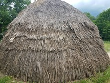 Brown Straw Or Wood House Or Hut With Thatch Roof
