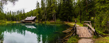 Wonderful Emerald-colored Lake With Wooden Bridge And Cabin Near Cortina D'Ampezzo In The Dolomites, Italy