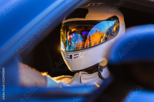 Canvas Prints F1 A Helmeted Driver At The Wheel Of His Race Car