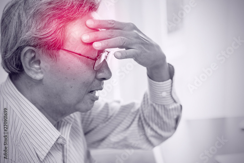 Fotografija Asian elder pain from headache stress danger of stroke syndrome
