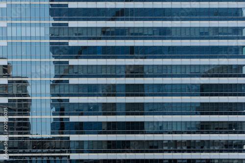 Staande foto Stad gebouw Windows of modern city business building skyscraper, background, texture