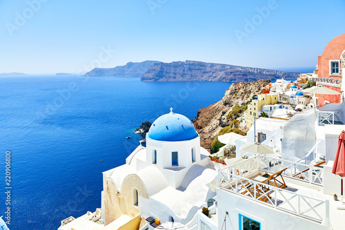 white houses with blue roofs on Santorini