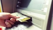 Man Hand Taking Dollar Bills O...