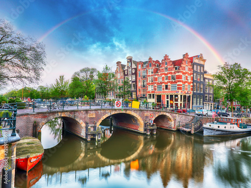 Deurstickers Centraal Europa Amsterdam canal with typical dutch houses and rainbow, Holland, Netherlands.