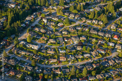 Aerial view of the residential homes during a vibrant sunny summer day. Taken in North Vancouver, British Columbia, Canada.