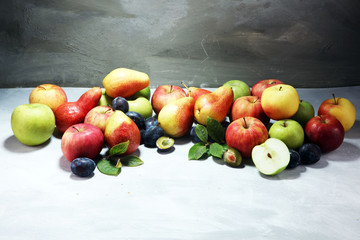 Various fresh fruits. Thanksgiving apples, and pears on rustic background.
