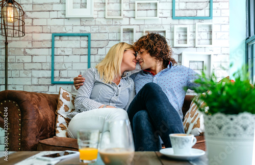Fotografie, Obraz  Couple kissing on a sofa in a coffee shop