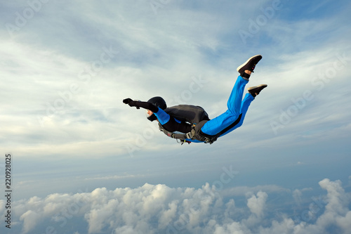 Fototapeta  Skydiving. Girl is in the sky.