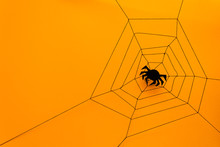 Black Paper Spider With Web On Yellow Background. Halloween Concept. Paper Cut Style. Top View