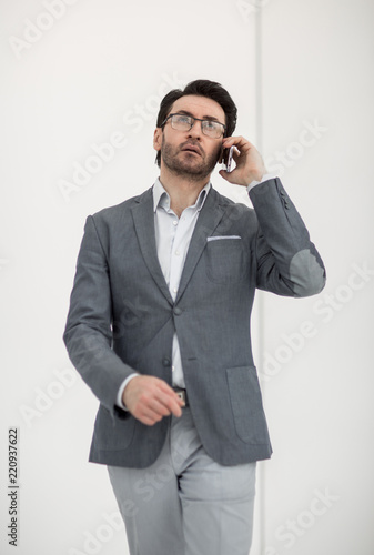 serious businessman talking on a smartphone Canvas Print
