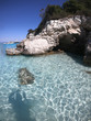 Sea level underwater photo of tropical caribbean paradise turquoise beach in exotic island located in an ocean