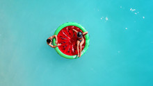 Aerial Drone Top Photo Of Unidentified Couple Sitting In Inflatable Watermelon In Tropical Paradise Beach Resembling A Pool