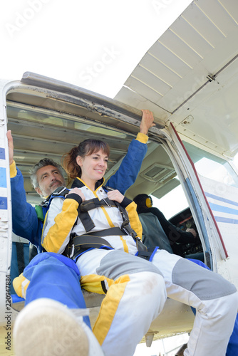 Man and woman poised to jump from aircraft