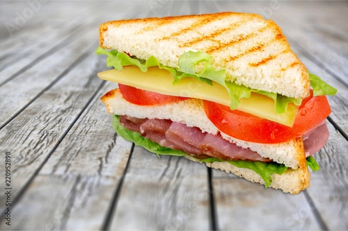 Fresh tasty sandwiches on wooden background