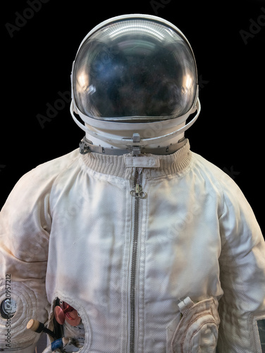 Fotografija Soviet cosmonaut or astronaut or spaceman suit and helmet on black background
