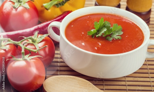 Bowl of gazpacho or tomato soup with ingredients