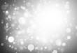 Gray glitter sparkles rays lights bokeh Festive Elegant abstract background.