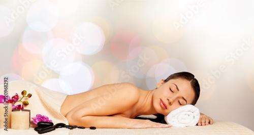 Obraz Beautiful young woman relaxing with stone massage at beauty spa - fototapety do salonu