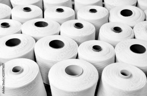 white yarn on spool, yarn on tube, cotton, wool, linen thread Canvas Print