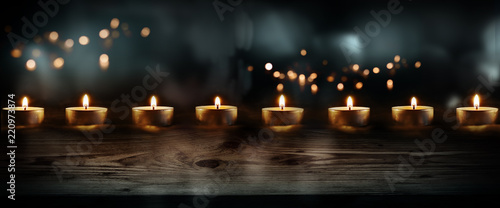 Candles on dark blue background