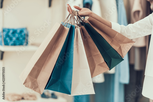 Fototapeta Closeup Young Girl holding Shopping Bags in Store obraz
