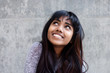 canvas print picture - Close up young Indian woman smiling and looking up