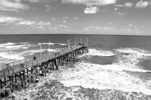 People Fishing On Pier At Daytona Beach, Florida