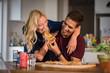 Couple enjoying eating pizza