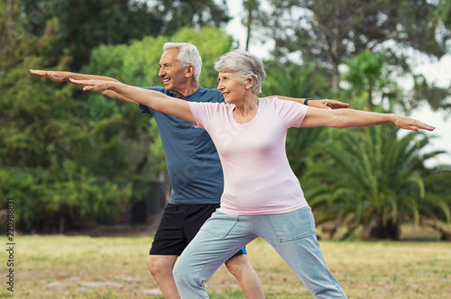 Leinwand Poster Old man and woman doing stretching exercise