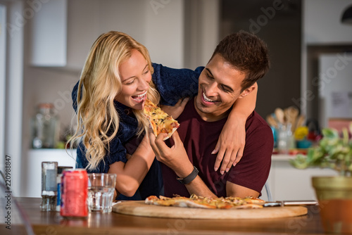 Couple enjoying eating pizza