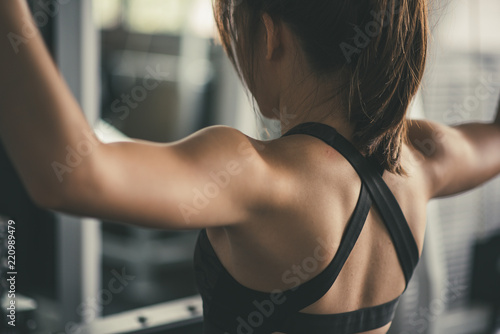 woman exercising building muscles at gym