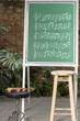 Teacher teaching musical notes on green chalkboard