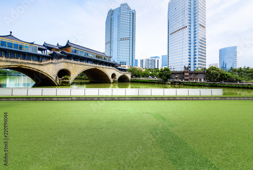 The square with lawn and the modern city skyline are in chengdu, China.