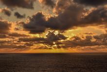 Glorious Orange Sky As Sun Rays Spread Across The Horizon Just Before Sunset On The Caribbean Sea.