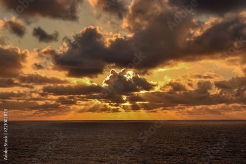 Glorious orange sky as sun rays spread across the horizon just before sunset on the Caribbean Sea.